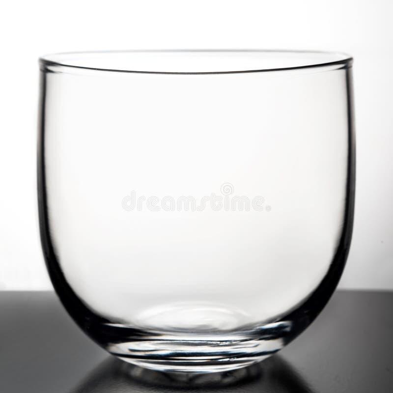 Glass genomskinlig bägare arkivbilder