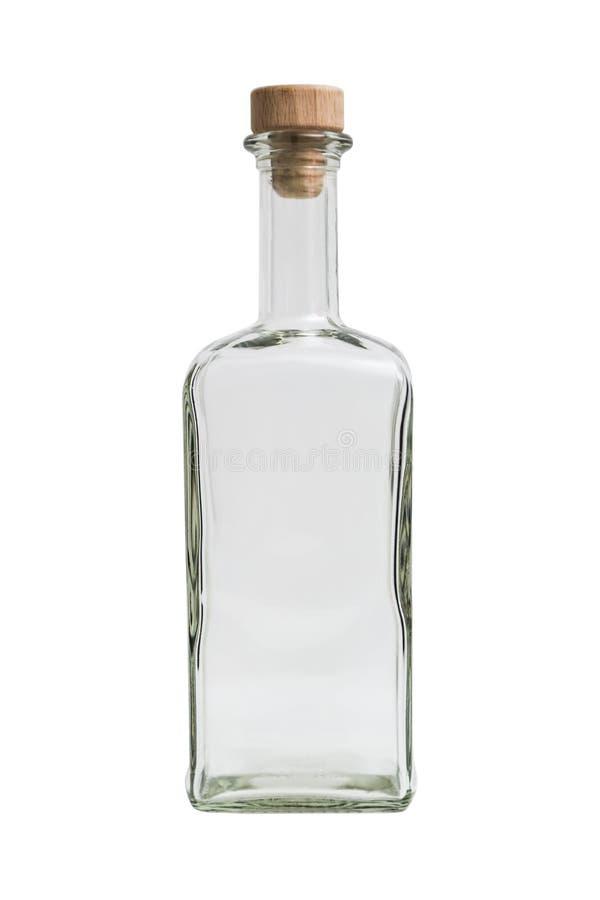 Glass genomskinlig tom enkel fyrkantig flaska med proppen på isolerad bakgrund arkivfoto
