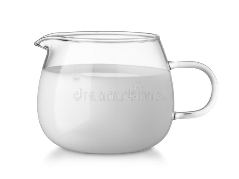 Glass glass creamer full of fresh cream royalty free stock images