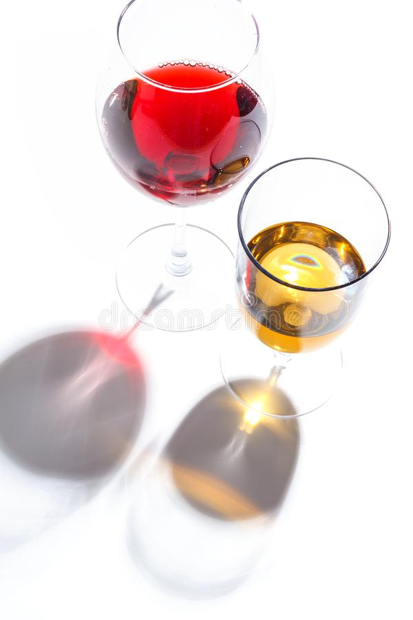 Glass glasses with drinks of different colors on a white background. Top view. The concept of an alcoholic cocktail royalty free stock photography