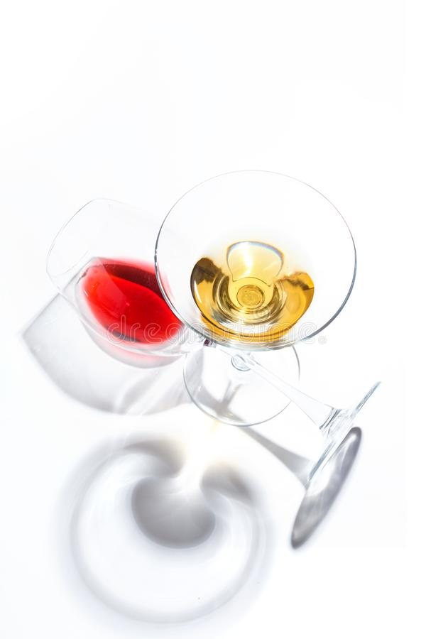 Glass glasses with drinks of different colors on a white background. Top view. The concept of an alcoholic cocktail royalty free stock images