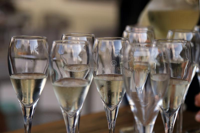 Glass glasses with prosecco - setting up the glasses on the table in the restaurant for an aperitif stock images