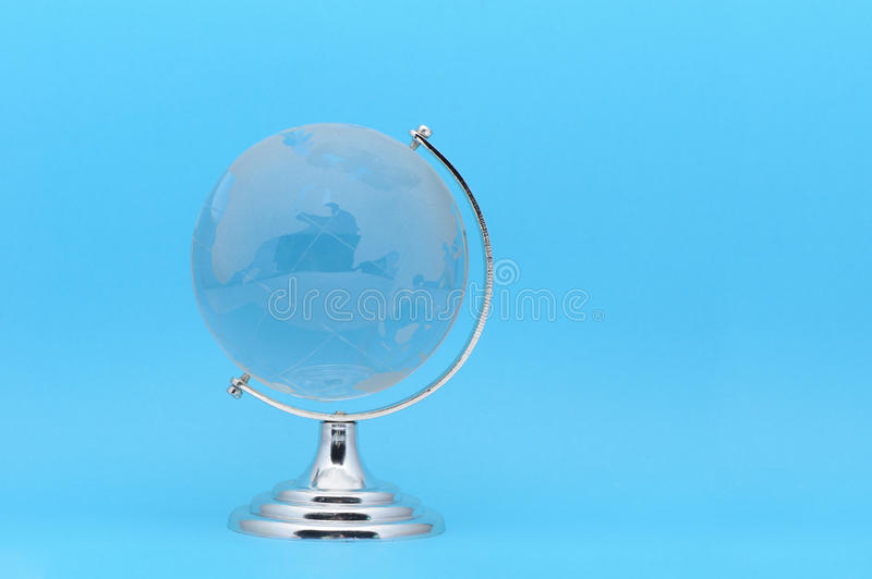 The glass globe. It is isolated on a dark blue background stock images