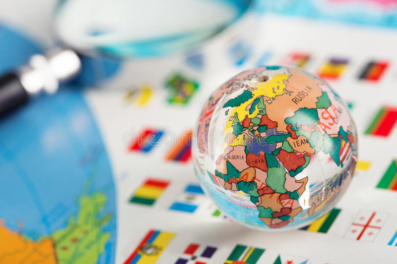 Glass globe on the flags stock photo