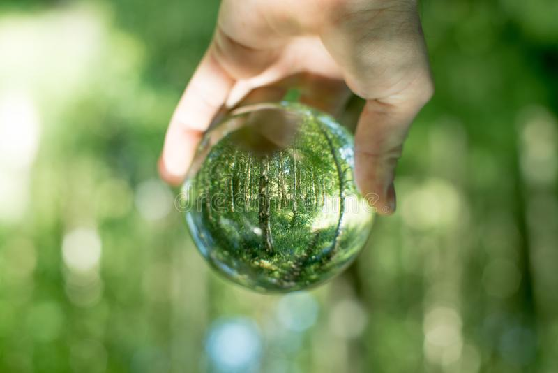 Glass globe in the hand royalty free stock photography