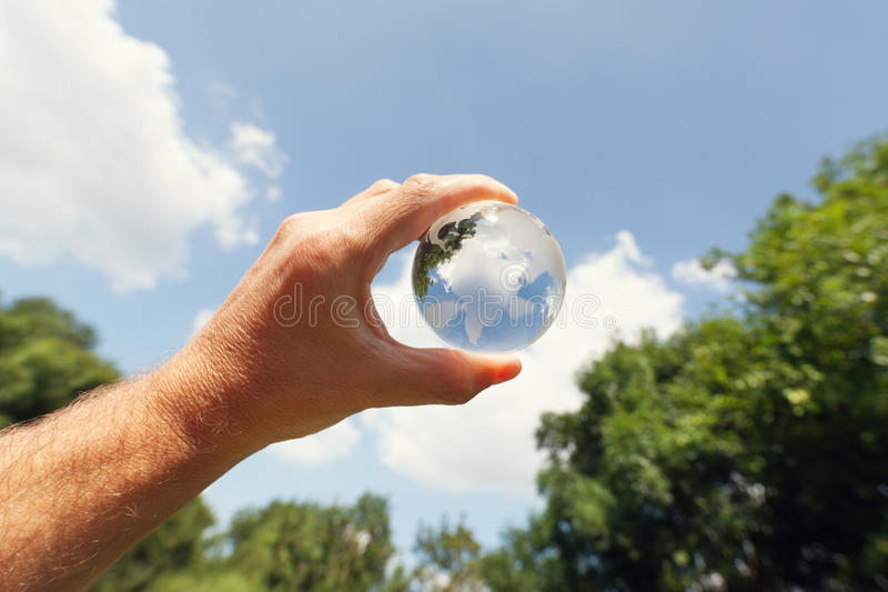 Glass globe in nature stock photography