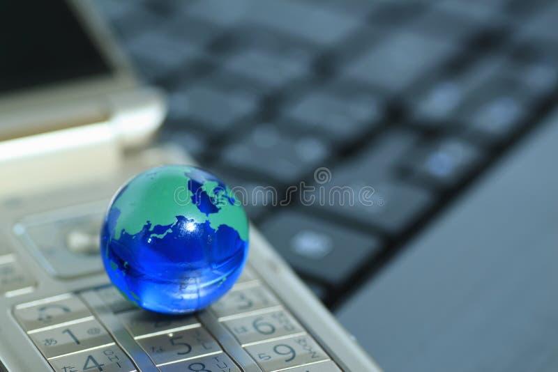 Glass globe over cellphone