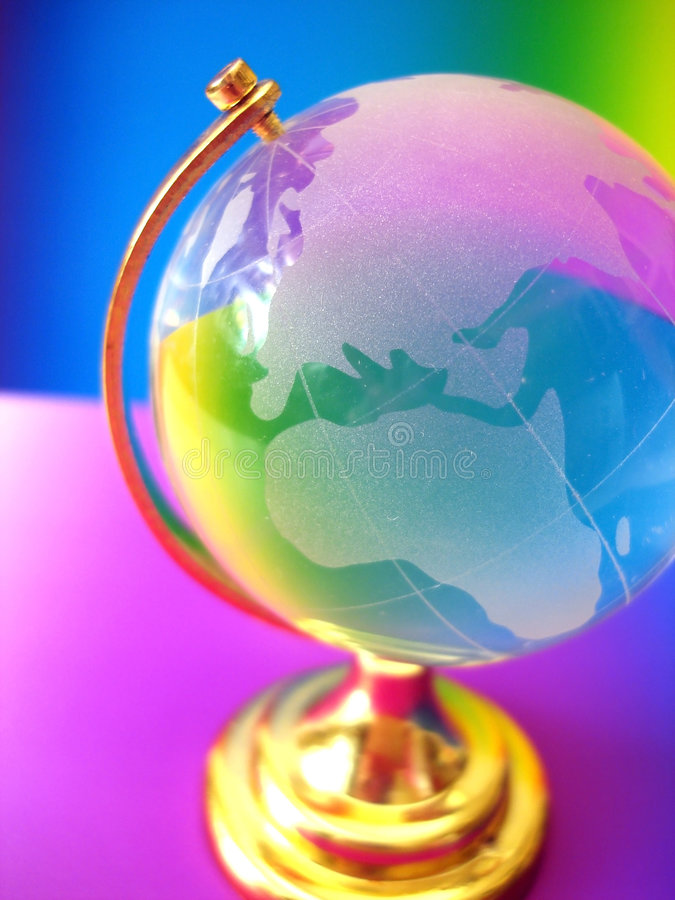Glass globe of the world. On colored background royalty free stock photography