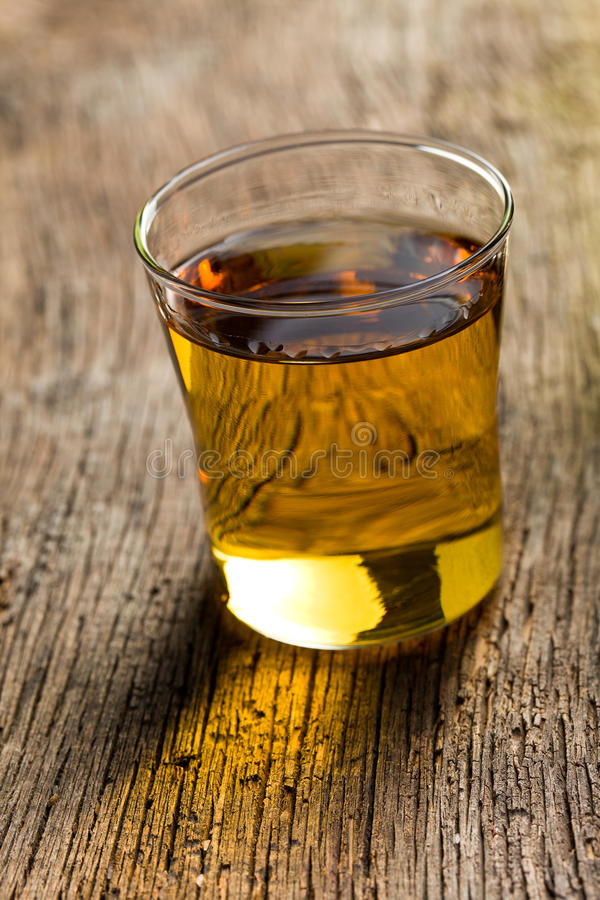 Download Glass of golden alcohol stock image. Image of cocktail - 26784183