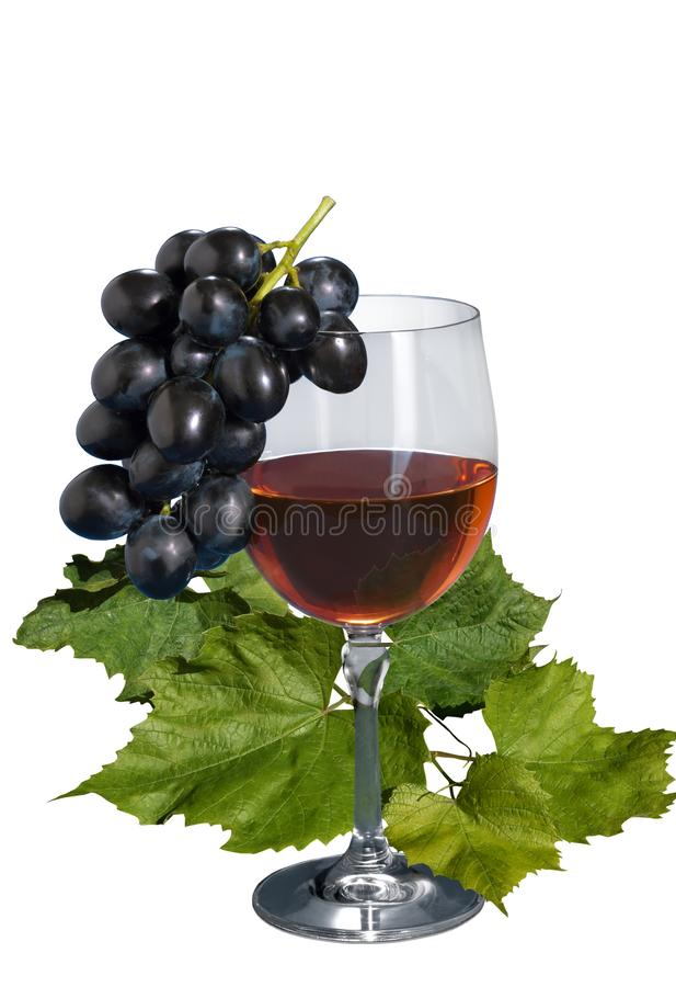 A glass of grape wine with grape leaves on an isolated white background stock image
