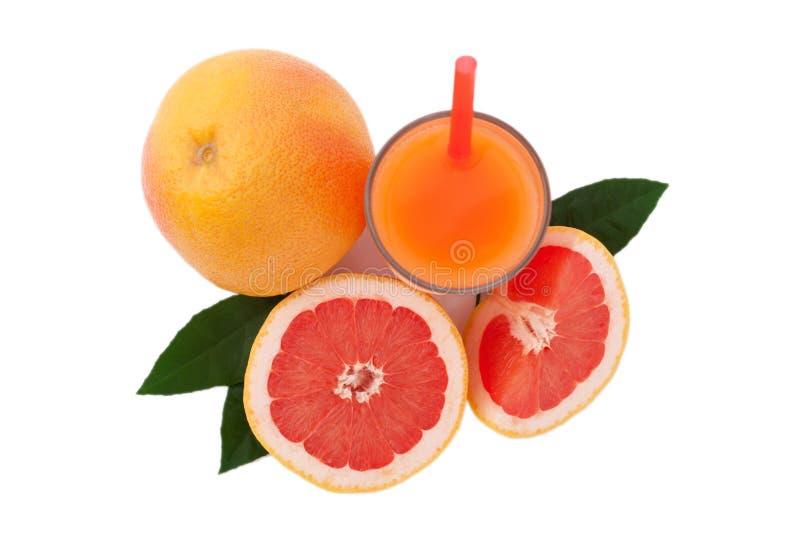 Glass of grapefruit juice isolated on white stock photos