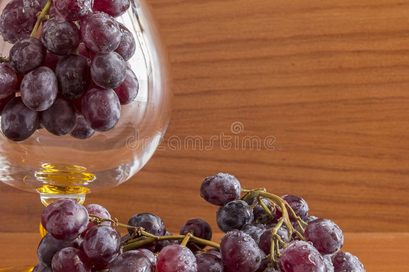 Glass and grapes royalty free stock images