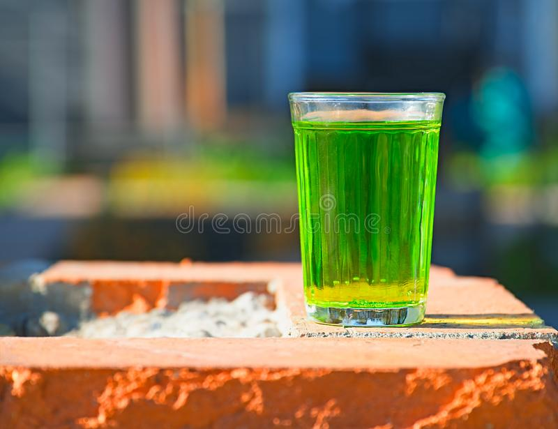 Glass of green acid soda object background. Horizontal orientation vivid vibrant bright color spacedrone808 rich composition design concept element shape stock images