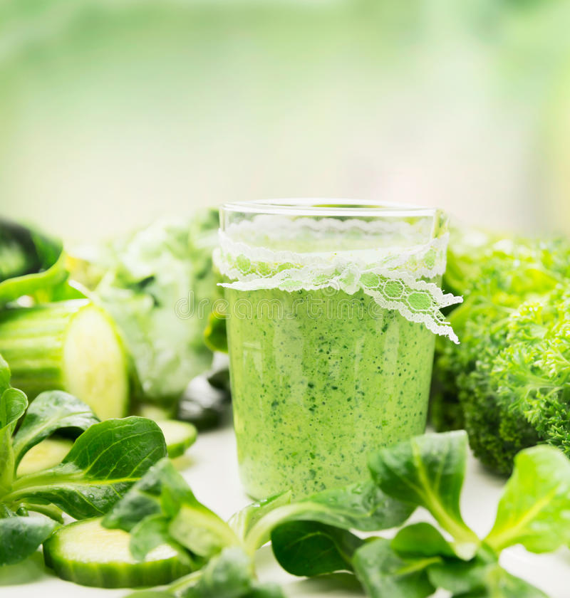 Glass of green herbs and vegetables smoothie stock image