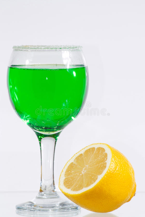The Glass Of Green Liquor And Lemon Royalty Free Stock Photos