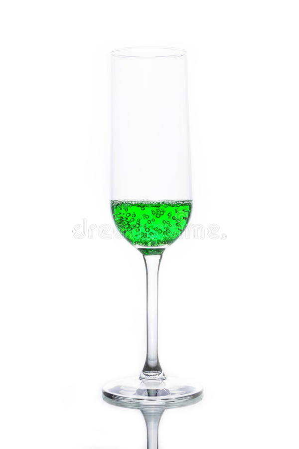 Glass with green sparkling water royalty free stock photos