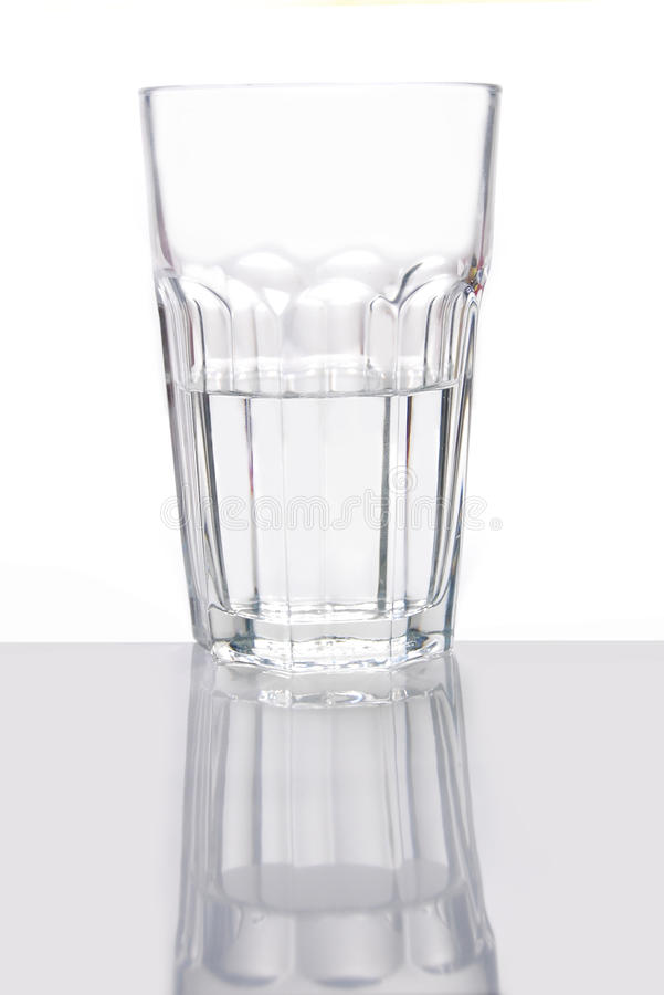 Glass half full. Half full and half empty glass of water stock images
