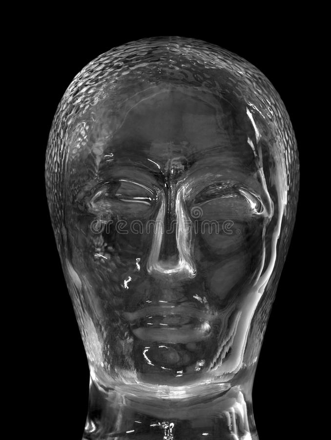 Glass head. Human head made of glass in black back stock images