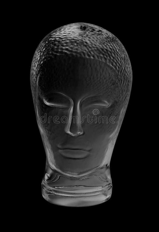 Glass head. Human head made of glass in black back royalty free stock image