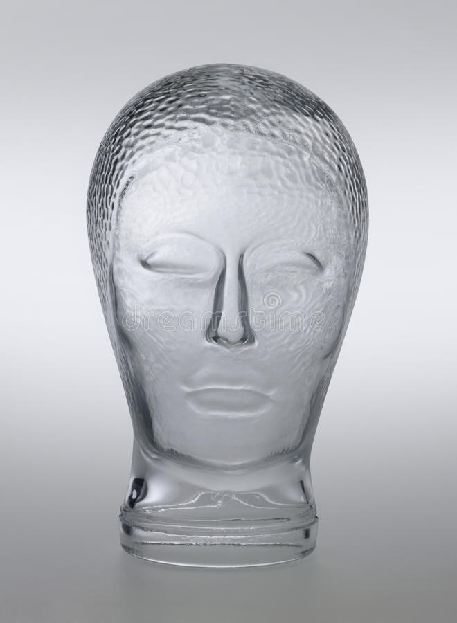Glass head profile. Profile shot of a generic human dummy head made of glass in gradient grey back, with clipping path stock images