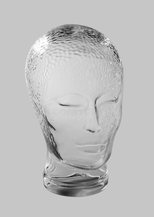 Glass head profile. Profile shot of a generic human dummy head made of glass in gradient grey back, with clipping path stock photos