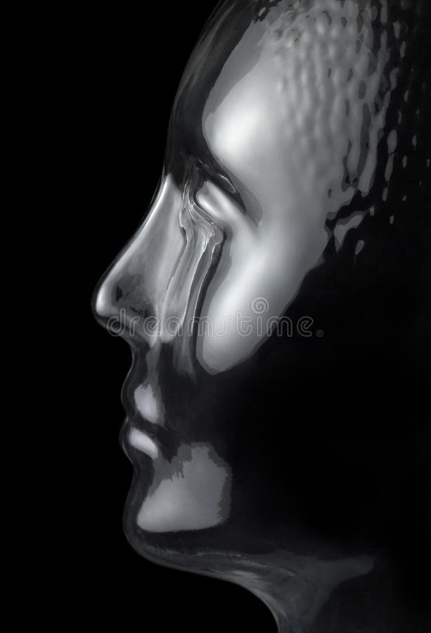Glass head profile. Translucent reflective human head made of glass in black back royalty free stock photos