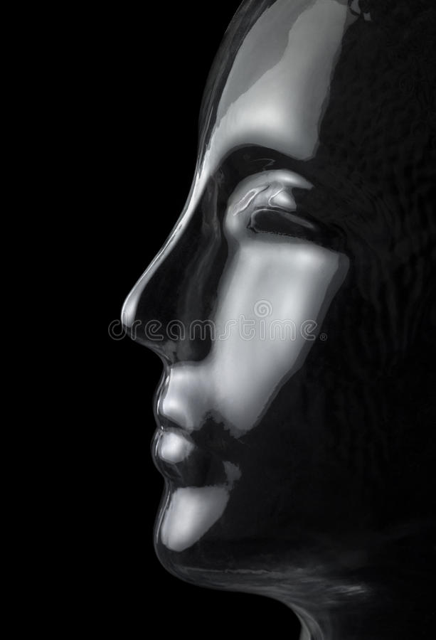 Glass head profile. Translucent reflective human head made of glass in black back royalty free stock image