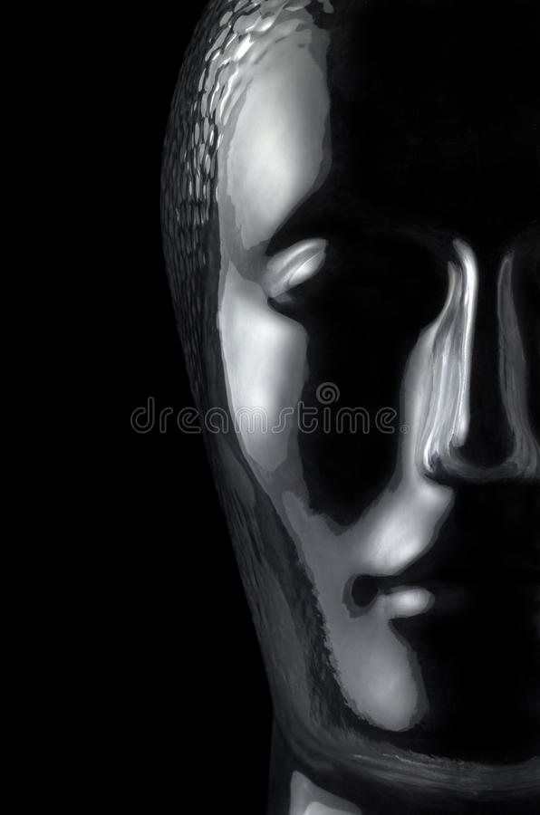 Glass head. Translucent reflective human head made of glass in black back stock photography