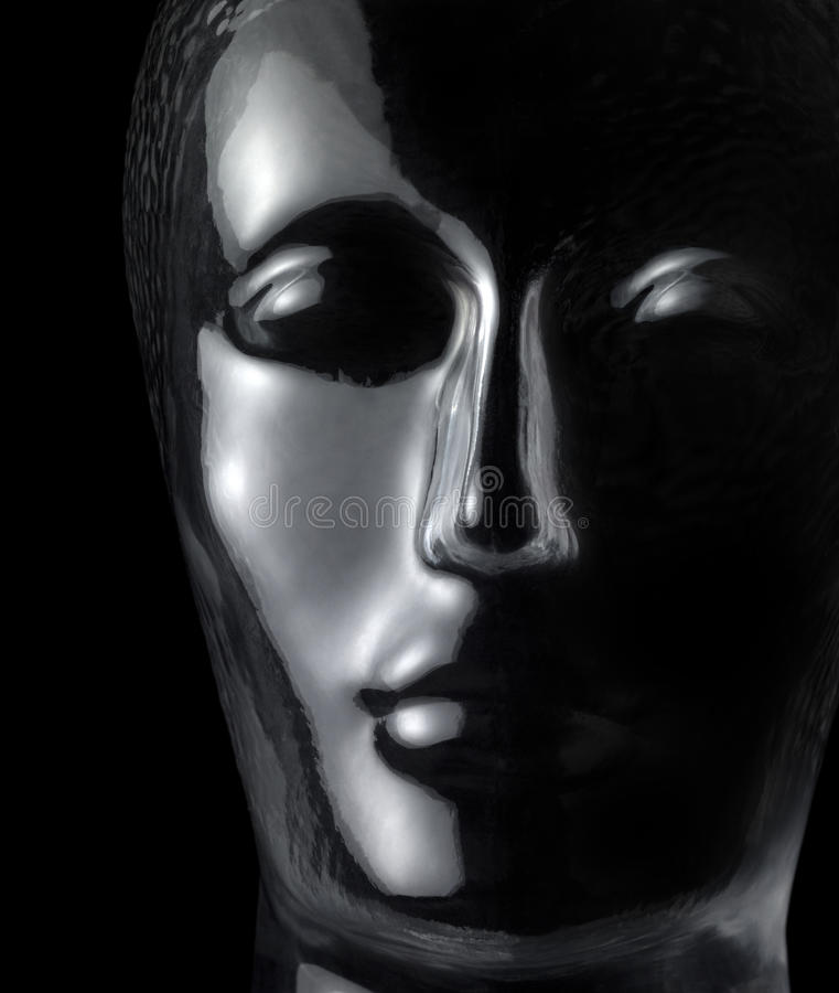 Glass head. Translucent reflective human head made of glass in black back stock photos