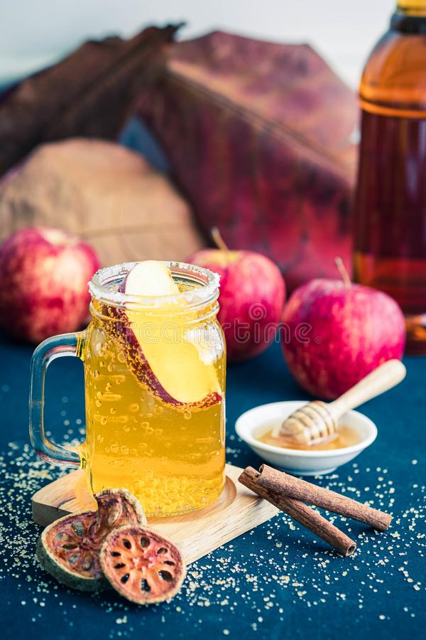 Glass of healthy bael tea with cinnamon, appel and honey. Glass of healthy bael, golden apple, tea with cinnamon, appel and honey stock photography