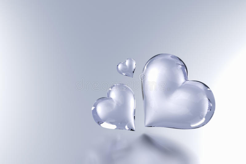 Glass Heart on grey colour background. 3D Render royalty free illustration