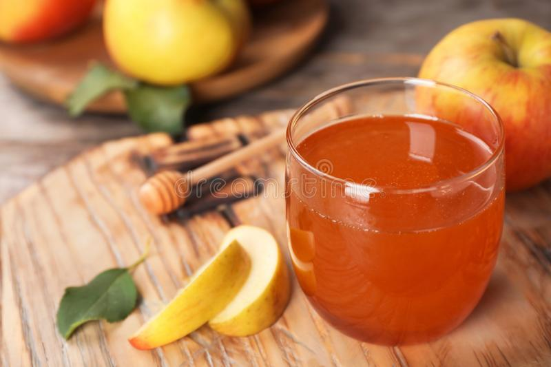 Glass of honey and apples stock photography