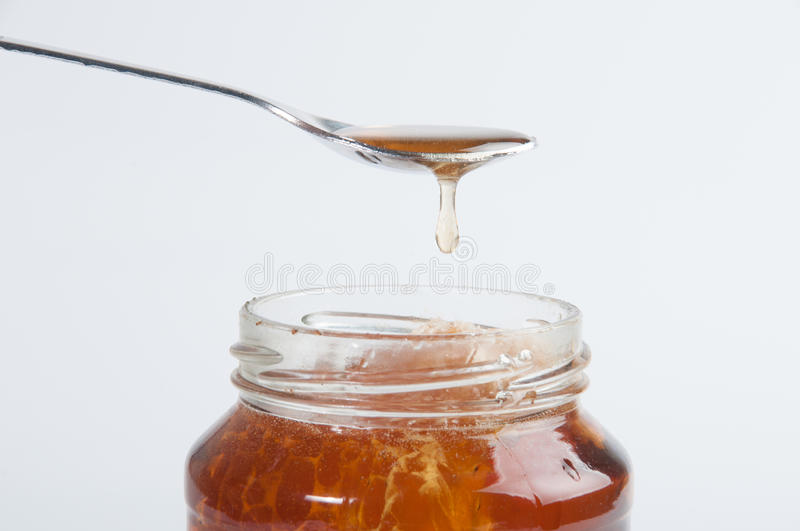 Download The glass honey jar stock image. Image of sticky, organic - 25971761