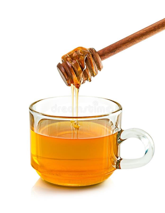Glass of honey stock photo