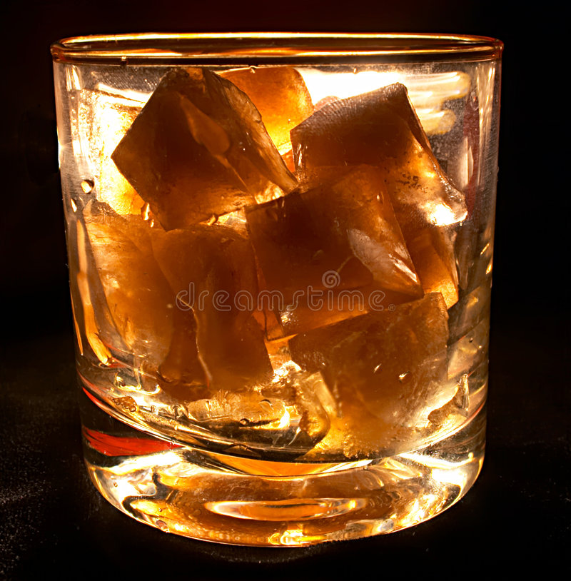 Glass with ice royalty free stock photos
