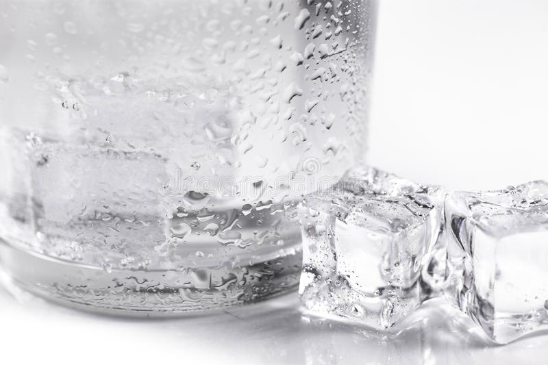 Glass with ice cubes closeup royalty free stock photography