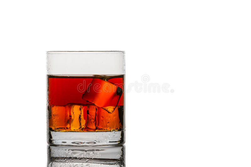 Glass with ice cubes and whisky. On white background royalty free stock photos