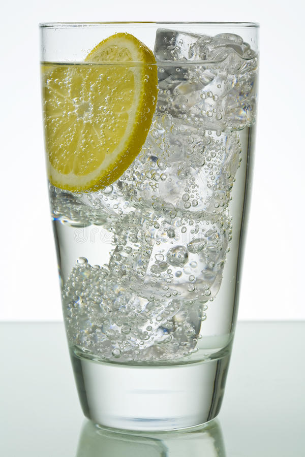 Glass with ice and lemon royalty free stock photo
