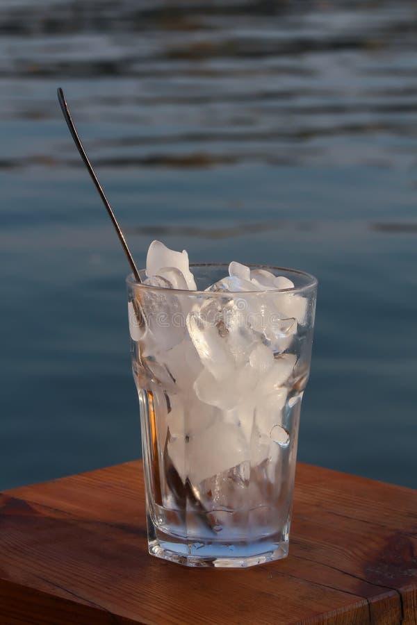 Glass of ice stock photos