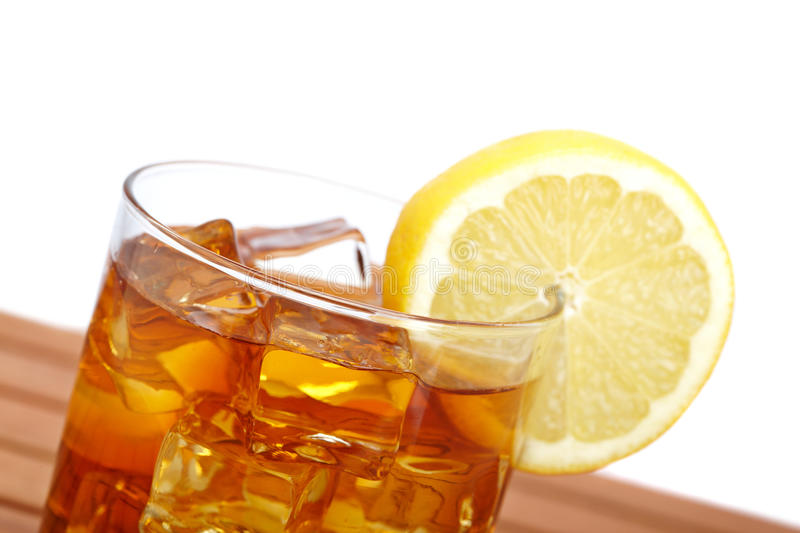 Glass of ice tea with lemon stock photography