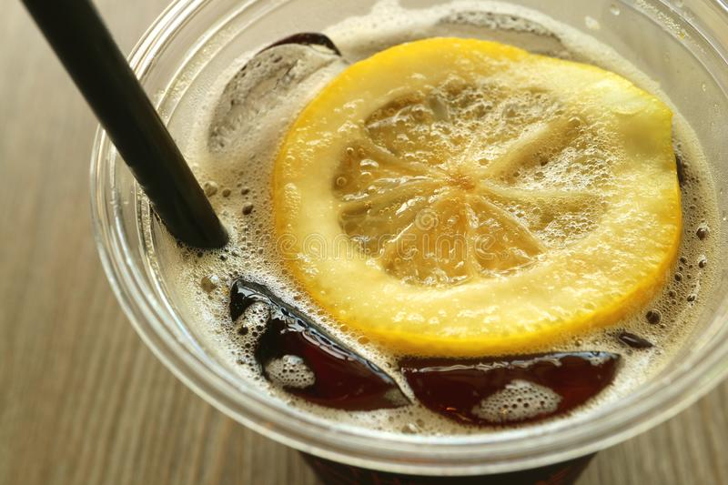 Glass of Iced Cola Soft Drink with Fresh Lemon Slice stock images