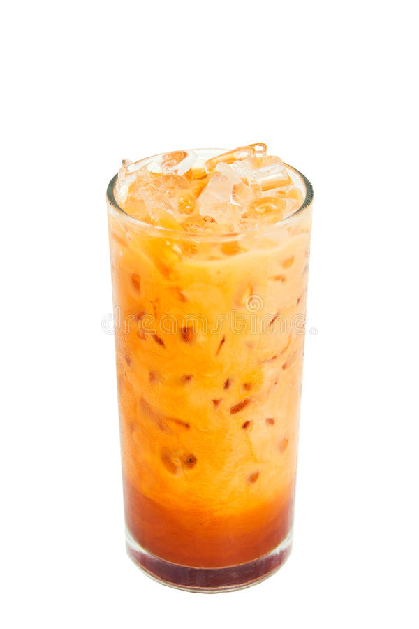 Glass of iced milk tea isolated on white background. A glass of iced milk tea, Thai style tea, isolated on white background royalty free stock image