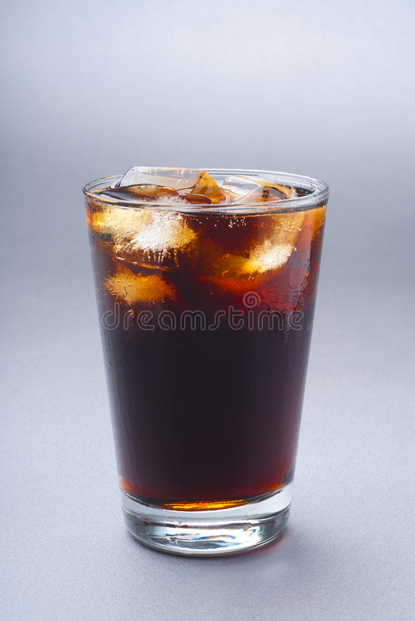 Glass of iced soda. A glass full of ice and carbonated soda royalty free stock photo