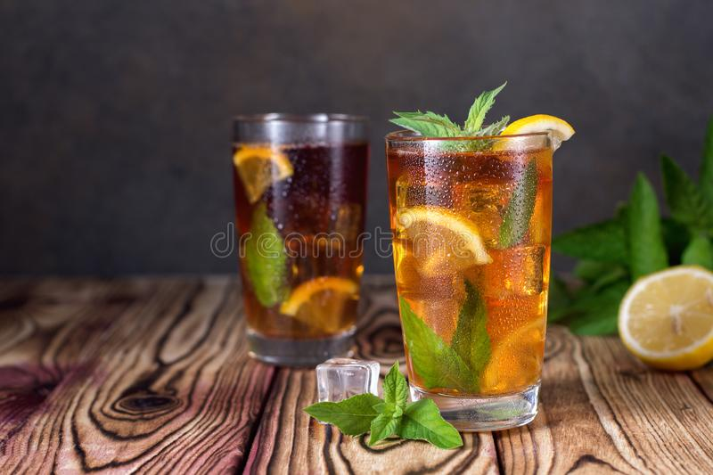 Glass of iced tea with mint and lemon. Cold drink. Rustic style royalty free stock photos
