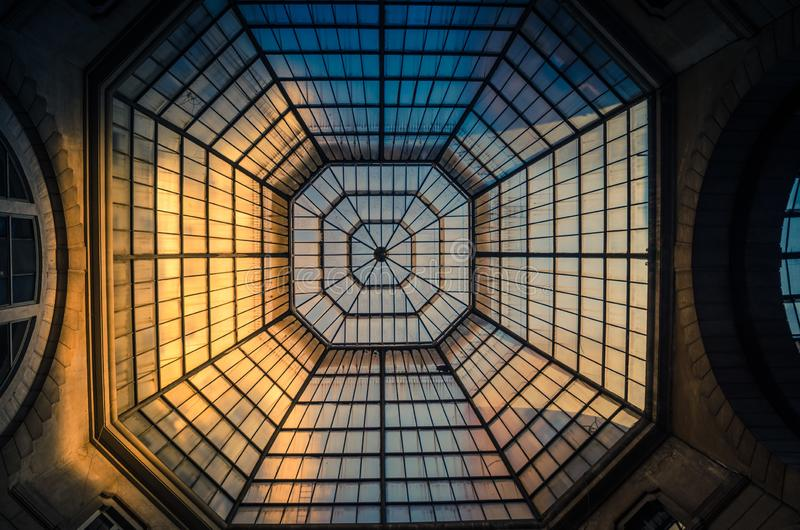 Glass and iron patterned ceiling roof of huge dome view from below. Glass and iron patterned ceiling roof of huge dome of shopping mall, view from below, Milan royalty free stock photography