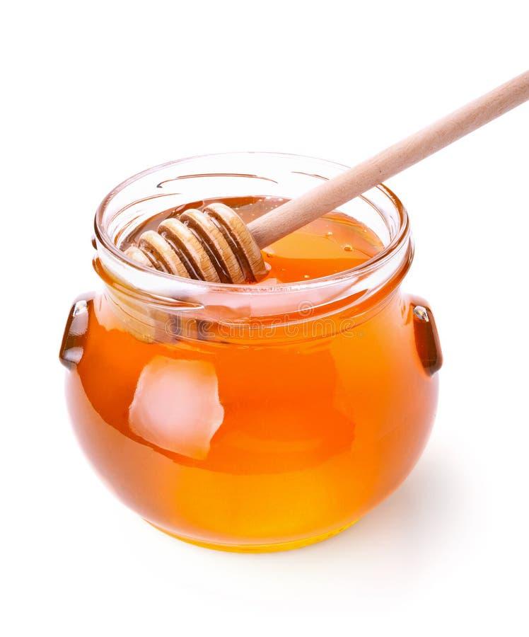 Glass jar av honung med trädrizzler royaltyfri foto