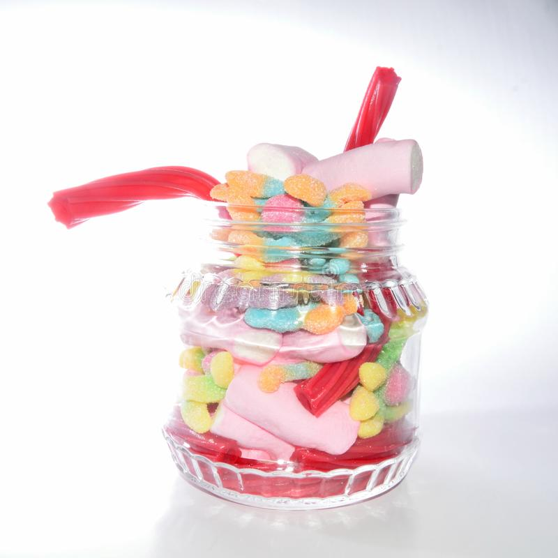 Glass jar with candies royalty free stock images