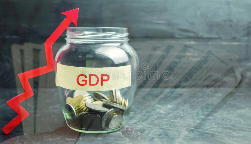 Glass jar with coins and the inscription ` GDP ` and up arrow. Business, economic, finance, salary, crisis. Economic growth concep stock photography