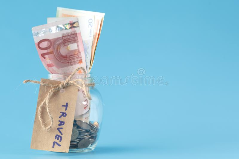 Glass jar with euro banknotes for travel royalty free stock images