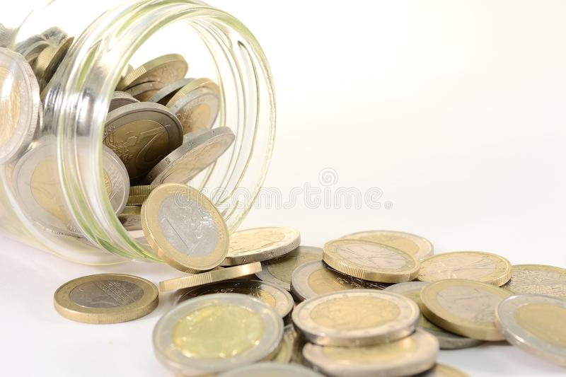 Glass jar with euro coins. Glass jar full of euro coins, saving concept stock images